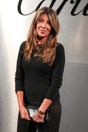 Nina Garcia accessorized with a black exotic-skin clutch at the Santos de Cartier watch launch.