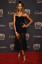 Jourdan Dunn made a seductive choice with this sheer, strapless black dress by Jonathan Simkhai for the Cartier Fifth Avenue grand reopening.