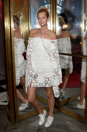 Toni Garrn was a boho babe in a white lace off-the-shoulder dress at the Cartier Fifth Avenue grand reopening.