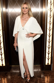Taylor Schilling styled her dress with a pair of tricolor evening sandals.