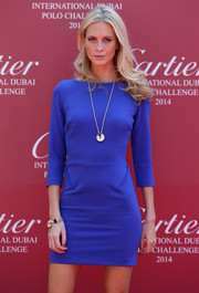 Poppy Delevingne styled her dress with an Amulette de Cartier bracelet and a matching necklace.