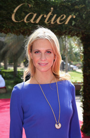 Poppy Delevingne attended the Cartier International Dubai Polo Challenge wearing an Amulette de Cartier necklace.