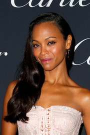 Zoe Saldana looked glam with her side-swept waves at the Cartier Juste Un Clou event.
