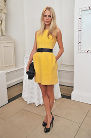 Poppy Delevigne paired her buttercup-colored frock with a pair of black peep toe platform pumps.