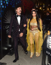 Kim Kardashian came dressed as Cher in an embellished yellow crop-top to the Casamigos Halloween party.
