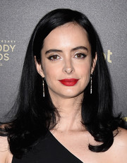 Krysten Ritter finished off her look with a vibrant red lip.