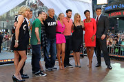 Robin Roberts stood out in her bright orange long-sleeve dress on the set of 'Good Morning America.'