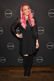 Kandee Johnson completed her outfit with a pair of black over-the-knee boots.