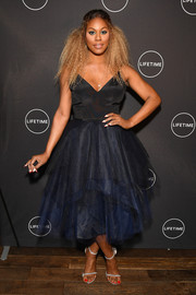 Laverne Cox finished off her look with a pair of gray slim-strap sandals.