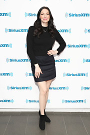 A pair of ankle boots rounded out Laura Prepon's dark ensemble.