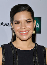 America Ferrera finished off her makeup with some coral lipstick.