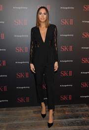 Louise Roe went for easy sophistication in a black lace-panel jumpsuit with a deep-V neckline when she attended the SK-II Change Destiny Forum.