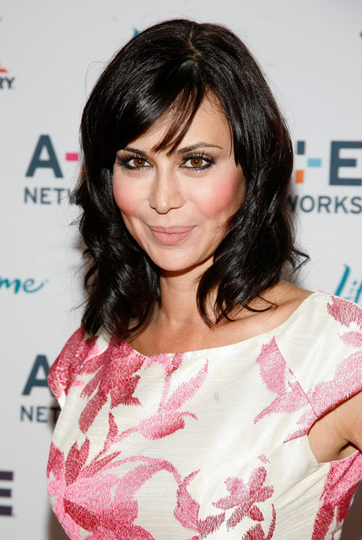 Catherine Bell Medium Wavy Cut with Bangs