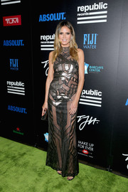 Heidi Klum looked ravishing in a sheer black and silver patchwork gown by J. Mendel at the Celebration of Music with Republic Records event.