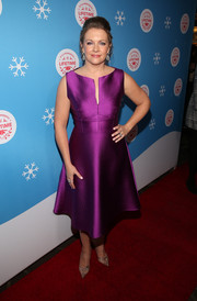 Melissa Joan Hart looked gorgeous in a shimmering purple cocktail dress at the VIP opening of the life-sized Gingerbread House.