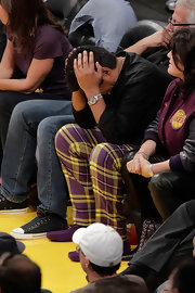 George shows his Laker's pride with a bold pair of purple and yellow plaid pants.  The matching purple loafers add a nice touch!  Although it doesn't look like it's helping his team too much.