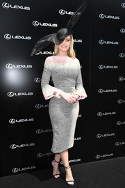 Lady Kitty Spencer attended Melbourne Cup Day wearing a Roland Mouret sheath dress, in gray with a pastel neckline and cuffs.