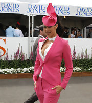 Megan Gale showed her love for pink with this fascinator and pantsuit combo during Caulfield Cup Day.