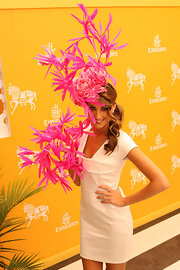Laura Dundovic really stole the limelight with this elaborate pink floral headdress during Crown Oaks Day.