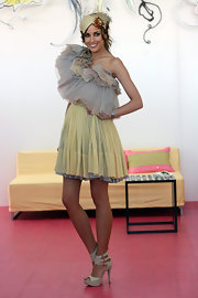 Rebecca is all ruffles in an fluffy one-shoulder cocktail dress. So avant-garde!