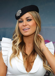 Carmen Electra paired her summery white dress with a beret which featured a sparkling brooch.
