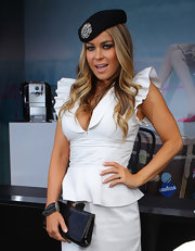 Carmen Electra paired her sexy white ensemble with a patent leather clutch.