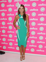 Vogue Williams wore a sea green body-hugging dress with white geometric details that brought out the mod in her at Crown Oaks Day.