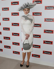 Proper peep-toe slingbacks were the perfect finishing touch to Nicole's ladylike Derby Day look.