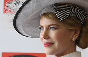 As to not compete with her statement-making hat, Nicole flashed these decadent diamond studs on Derby Day 2012.