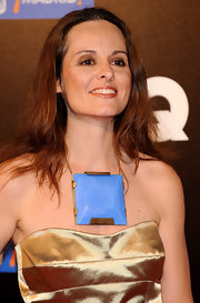 Ana paired her statement necklace with a gold strapless dress.