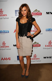 Rebecca sported a warm brown style with side-parted curls.