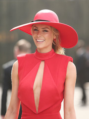 Jennifer Hawkins rocked a red-on-red Melissa Jackson wide-brimmed hat and Misha Collection jumpsuit combo during Melbourne Cup Day.