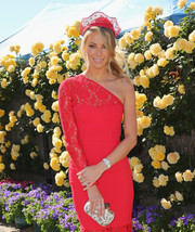 Jennifer Hawkins accessorized her pink dress with a white and silver hard-case clutch during Melbourne Cup Day.