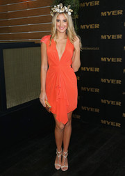 Laura Dundovic looked very feminine in a draped orange Aurelio Costarella cocktail dress with a plunging neckline during Melbourne Cup Day.