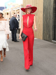 Jennifer Hawkin's attended Melbourne Cup Day wearing a sleek red cutout jumpsuit by Misha Collection that was a perfect match for her enviably svelte physique!