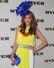 Rebecca Judd wore a feathered royal blue hat with her color-blocked ensemble for Melbourne Cup Day.