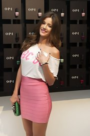 Malena Costa attended the OPI Nails event wearing a bandage mini skirt and a loose off-the-shoulder top.
