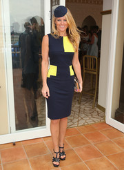 Simone Callahan donned a sleeveless blue and yellow sheath dress for Oaks Day.