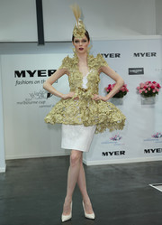 Coco Rocha made a grand entrance during Oaks Day in a beige tutu-silhouette coat by Anthony Capon layered over a white dress.