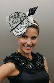Rachael Finch got in the spirit of Victoria Derby Day wearing a feather and bowed headband.