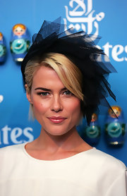 Rachel Taylor topped off her exquisite Victoria Derby Day look with a black tulle head piece.