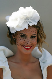 Laura Dundovic looked lovely in a white floral head piece with a black veil for Victoria Derby Day.