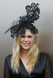 Alexandra Richards had fun in a black lace head piece for Victoria Derby Day.