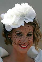 Laura Dundovic wore a fabulous red lipstick with her black and white hat at a celebration of Victoria derby day.