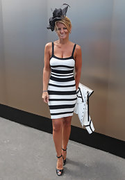 Simone Callahan topped off her black and white figure-flattering dress with black leather peep-toe heels.