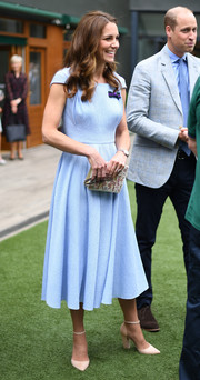 Kate Middleton kept it simple in a textured blue midi dress by Emilia Wickstead at Wimbledon 2019.