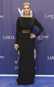 Kate Winslet carried an elegant metallic box clutch to the Yo Dona Awards.