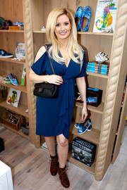 Holly Madison chose a stylish blue dress with knot detail and shoulder cutouts for the TOMS x Oceana event.