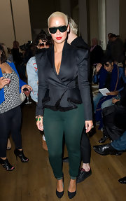 Amber topped off her green leggings with a bold blazer, which featured a fur embellished hemline.