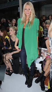 Poppy's Kelly Green asymmetrical blazer was MADE for Fashion Week.
